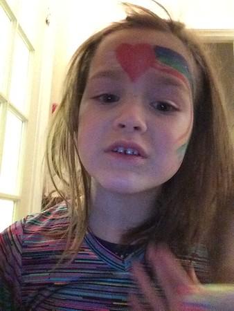Kiesten rainbow painted face, chloe  happy face too