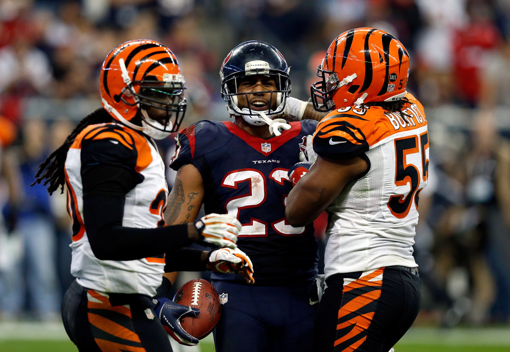 Description of . Arian Foster #23 of the Houston Texans reacts against Vontaze Burfict (R) #55 of the Cincinnati Bengals during their AFC Wild Card Playoff Game at Reliant Stadium on January 5, 2013 in Houston, Texas.  (Photo by Scott Halleran/Getty Images)