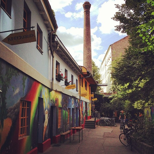 Regenbogenfabrik (Rainbow Factory). The story: in the 1980s, it was a squatter haven, for among other reasons to prevent the demolition of the old smokestack (background) and buildings. Now the squatters have legal rights to the building and have formed a