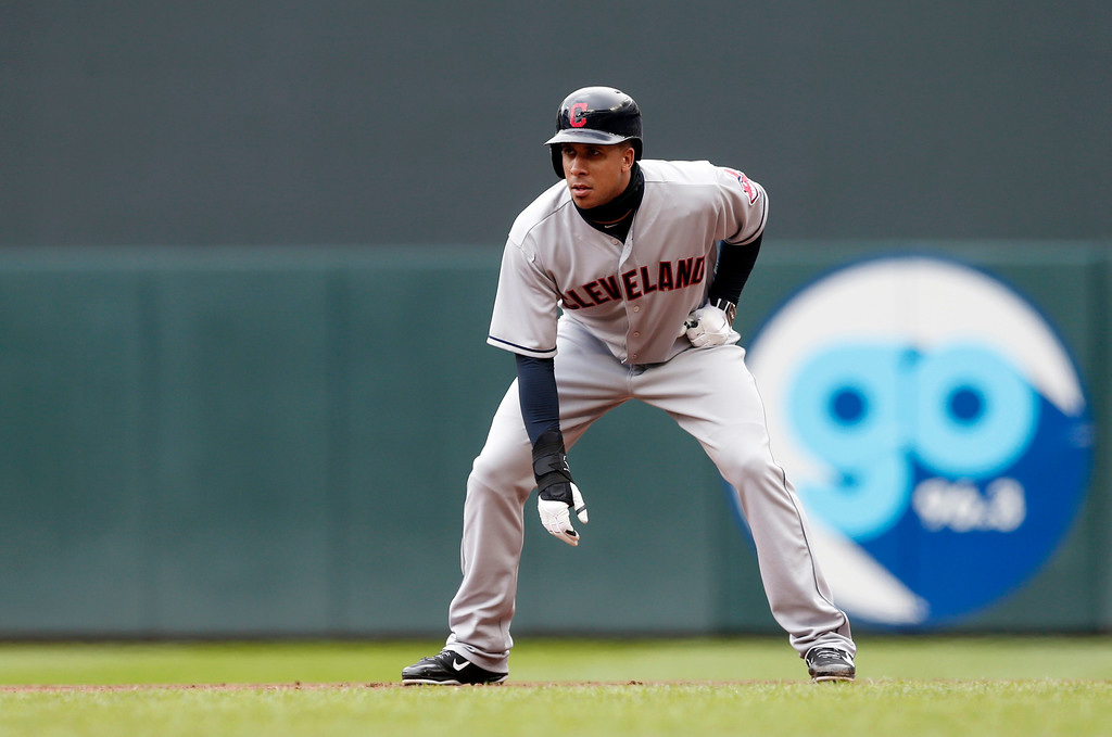 . Cleveland Indians\' Michael Brantley takes a lead off first base against the Minnesota Twins in a baseball game Thursday, April 20, 2017, in Minneapolis. (AP Photo/Jim Mone)