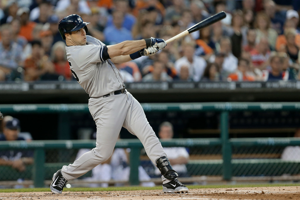 . New York Yankees\' Mark Teixeira hits a one-run double in the third inning of a baseball game against the Detroit Tigers in Detroit, Wednesday, Aug. 27, 2014. (AP Photo/Paul Sancya)