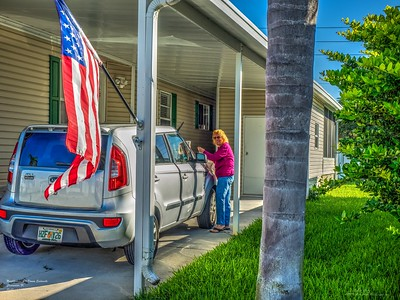 Daily sightings...2019-11-10...415 Donna Sadowski cleaning windows on her car.