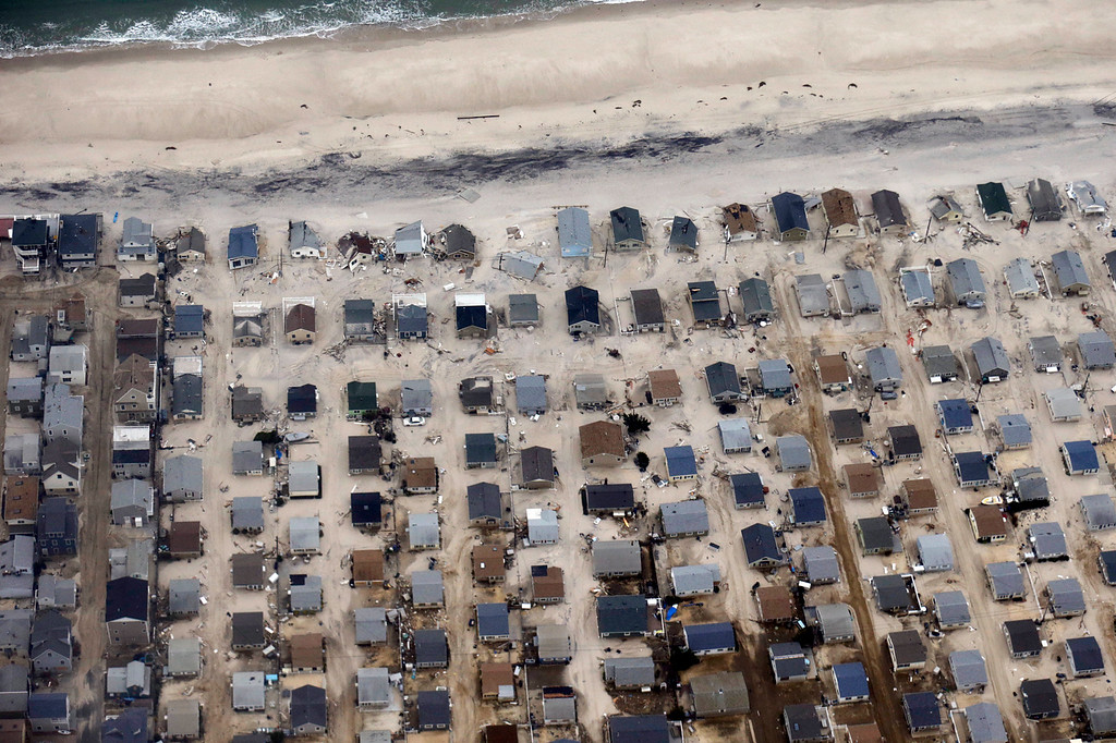 . In this aerial photo, sand covers the roads where several homes were destroyed or severely damaged by Superstorm Sandy in an area of Seaside Heights, N.J., Thursday, Nov. 1, 2012. The photo was taken during a flight to document coastal changes by the National Oceanic and Atmospheric Administration after the storm moved through the area. (AP Photo/Alex Brandon)