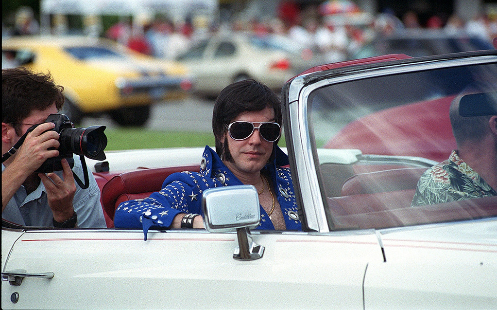 . Complete with his own personal photographer, Elvis made his way down Woodward sitting pretty in a white Cadillac.