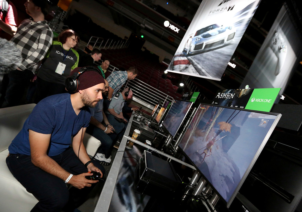 ". IMAGE DISTRIBUTED FOR MICROSOFT - Gamers play ""Ashen\"" at the Xbox Media Showcase at E3 2017 in Los Angeles on Monday, June 12, 2017. (Photo by Casey Rodgers/Invision for Microsoft/AP Images)"