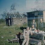 Group_eating_at_lumber_camp.jpg
