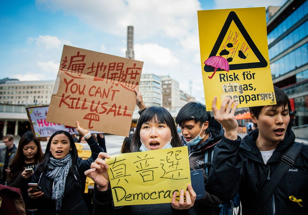 ". Pro-democracy protesters hold placards reading ""You can\'t kill us all\"" and \""Democracy\"" in support of the demonstrations currently blocking central Hong Kong that have been dubbed the \""umbrella revolution\"", on October 1, 2014 in Stockholm, Sweden. Hong Kong has been plunged into the worst political crisis since its 1997 handover as pro-democracy activists take over the streets following China\'s refusal to grant citizens full universal suffrage. JONATHAN NACKSTRAND/AFP/Getty Images"