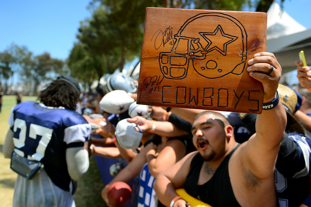 . Cowboys plead for autographs after the Cowboys-Raiders practice in Oxnard, Wednesday, August 13, 2014. (Photo by Michael Owen Baker/Los Angeles Daily News)
