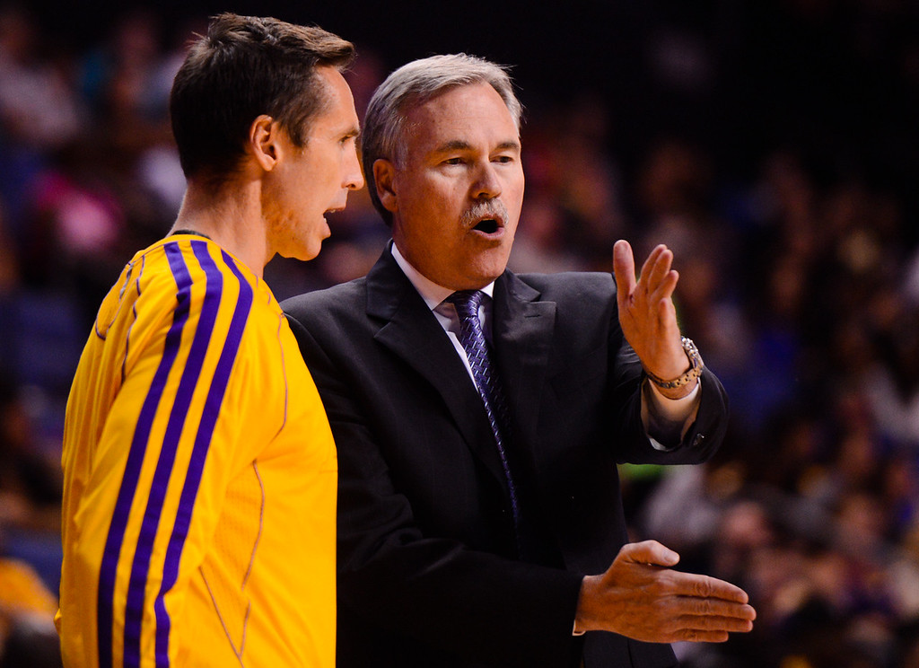 . Los Angeles Lakers head coach Mike D\'Antoni speaks to Lakers point guard Steve Nash during a timeout in a preseason game against the Golden State Warriors at the Citizens Business Bank Area in Ontario on Saturday, Oct. 5, 2013. (Photo by Rachel Luna / San Bernardino Sun)