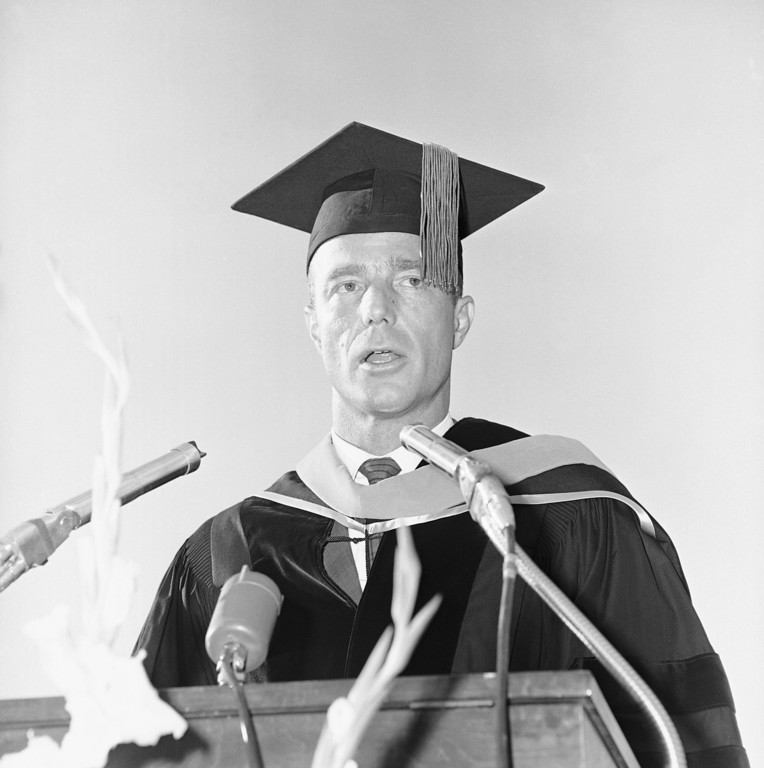 . In recognition of his heroic accomplishments as an astronaut and pilot of the space craft Aurora 7, M. Scott Carpenter, formerly of Boulder, Colorado was awarded the Norlin Award for distinguished achievement. Carpenter, clad in cap and gown at the University of Colorado graduation ceremony in Boulder on Friday, June 8, 1962, jokingly quipped that it had taken him twenty years to graduate and get his Bachelor of Science degree from Colorado University. (AP Photo)