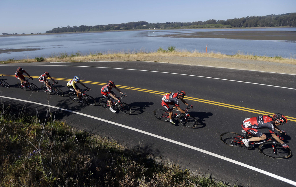 . Tour winner Tejay Van Garderen, third from left, rides with his BMC teammates along Bolinas lagoon during stage 8 of the Tour of California cycling race in Bolinas, Calif., Sunday, May 19, 2013. (AP Photo/Marcio Jose Sanchez)