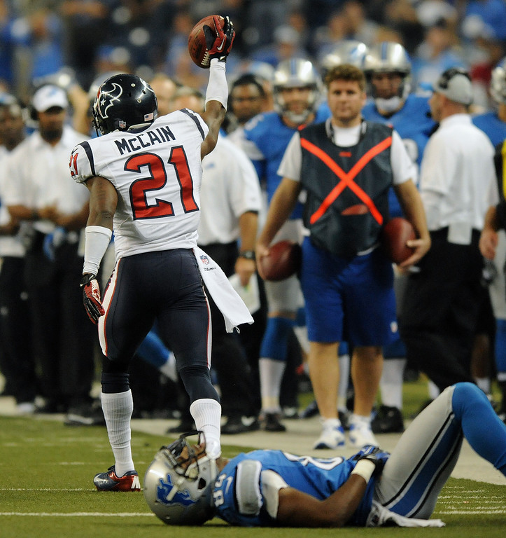 . Detroit Lions wide receiver Ryan Broyles, foreground, lies in disbelief after giving up an interception to Houston Texans cornerback Brice McCain during overtime.  The Texans beat the Lions,  34-31.  Photo taken on Thursday, November 22, 2012, at Ford Field in Detroit, Mich.  (Special to The Oakland Press/Jose Juarez)