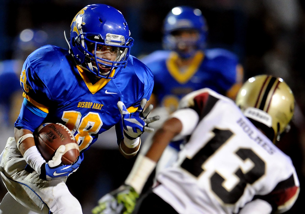 . Bishop Amat\'s Trevon Sidney catches a pass for a touchdown past Alemany\'s Desean Holmes (13) in the first half of a prep football game at Bishop Amat High School in La Puente, Calif., on Friday, Oct. 25, 2013.    (Keith Birmingham Pasadena Star-News)