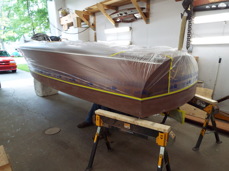 Port rear view of the boat masked ready for bottom paint.