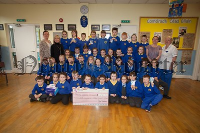 Cora Trainor and Bernie Ward from Cancer Research accept a cheque for £165 from pupils at Bunscoil an Luir the proceeds of sales of the Cancer Research Unity Bands. Also pictured is Maria Caragher and Dierdre McManus. R1610010