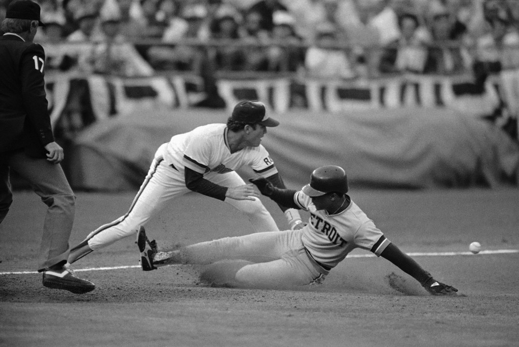 . Detroit Tigers Lou Whitaker slides into third base ahead of the ball as San Diego Padres third baseman Graig Nettles (left) awaits the throw at night, Wednesday, Oct. 10, 1984 in San Diego in World Series Game. Whitaker made it to third from first base on a first-inning hit-and-run single by Alan Trammell. (AP Photo)