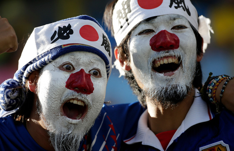 . Fans of Japan cheer before the group C World Cup soccer match between Japan and Colombia at the Arena Pantanal in Cuiaba, Brazil, Tuesday, June 24, 2014. (AP Photo/Felipe Dana)