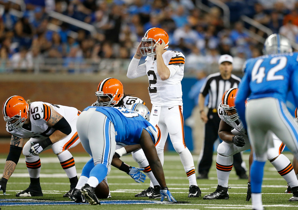 . Cleveland Browns quarterback Johnny Manziel (2) audibles against the Detroit Lions in the second half of a preseason NFL football game at Ford Field in Detroit, Saturday, Aug. 9, 2014. (AP Photo/Rick Osentoski)