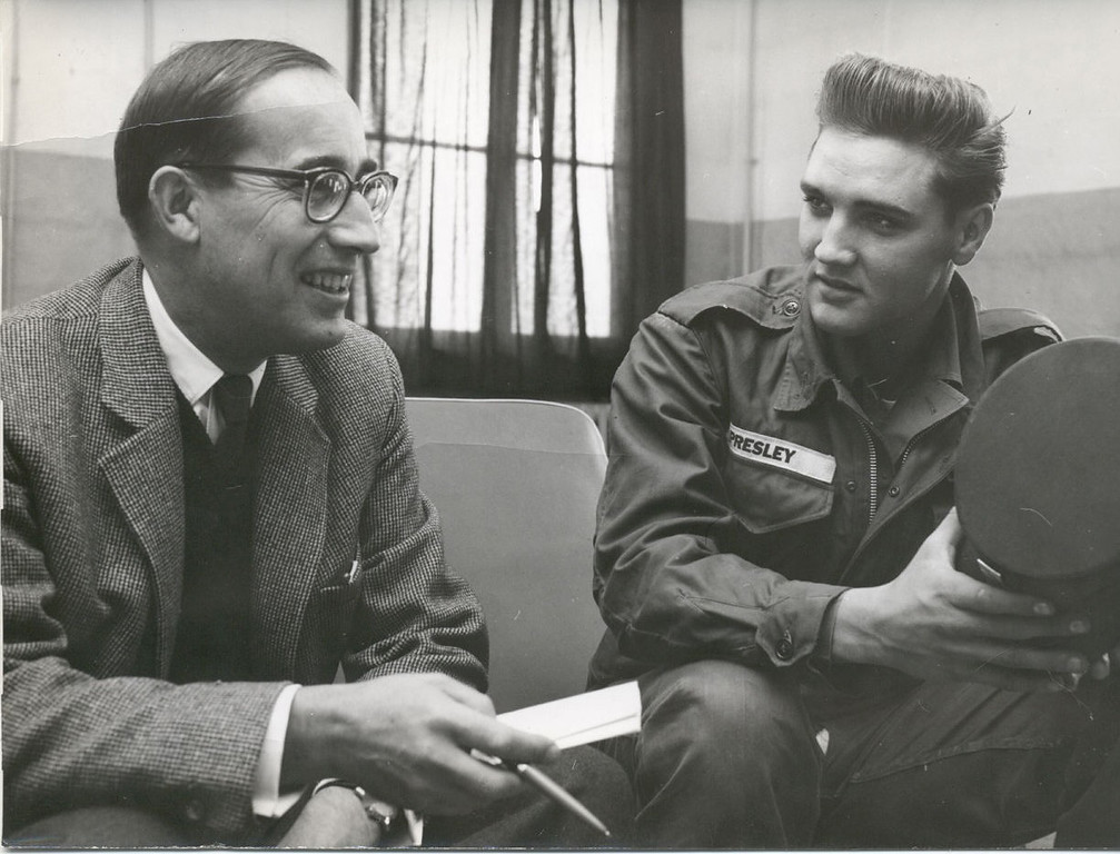 . FILE - This is an Oct. 1958 file photo of Associated Press chief of bureau for Germany Richard O\'Regan, as he interviews Elvis Presley.