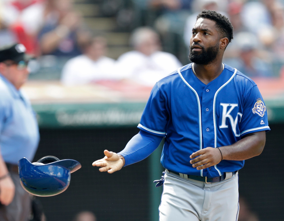 . Kansas City Royals\' Brian Goodwin tosses his helmet after striking out in the seventh inning of a baseball game against the Cleveland Indians, Wednesday, Sept. 5, 2018, in Cleveland. The Indians won 3-1. (AP Photo/Tony Dejak)