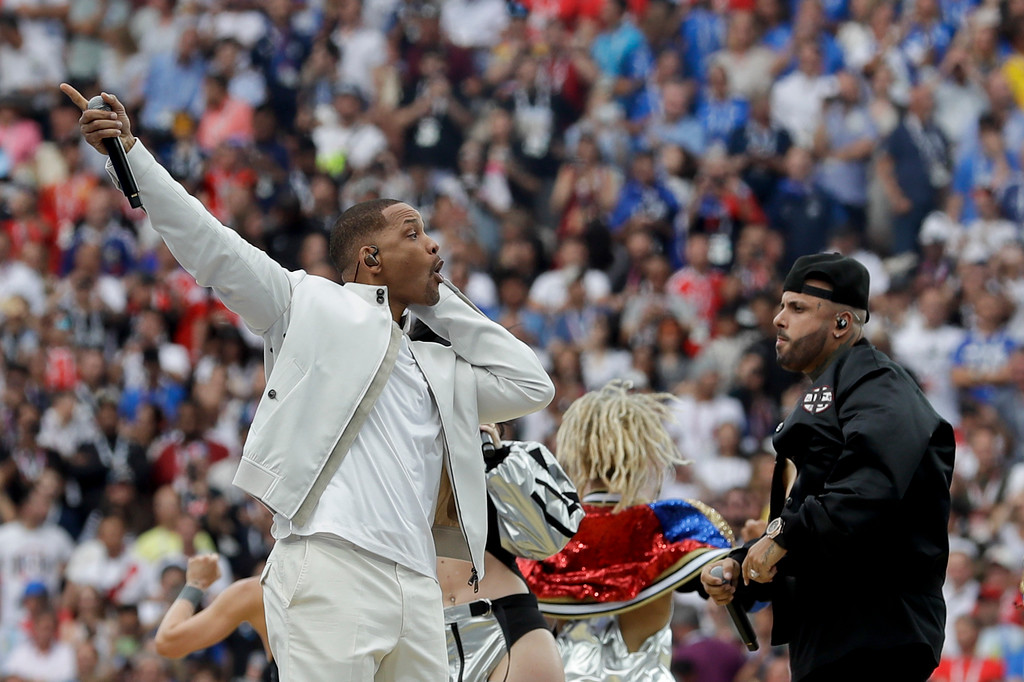 . Singer Will Smith, left, and Nicky Jam, right, perform during the closing ceremony prior to the final match between France and Croatia at the 2018 soccer World Cup in the Luzhniki Stadium in Moscow, Russia, Sunday, July 15, 2018. (AP Photo/Matthias Schrader)
