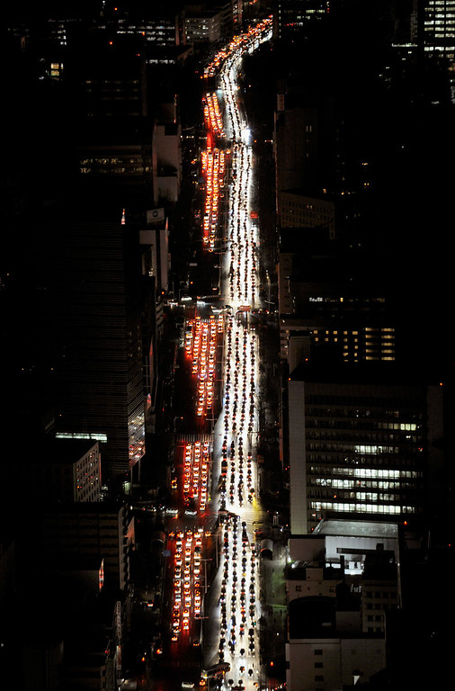 . Traffic is jammed on a road in Sendai city, Miyagi prefecture (state), Japan, after a powerful earthquake, the largest in Japan\'s recorded history slammed the eastern coasts Friday, March 11, 2011.  (AP Photo/Kyodo News)