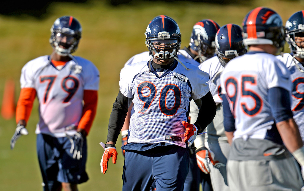 . Denver Broncos Shaun Phillips (90) warming up for the team practice at Dove Valley practice field, Englewood, Colorado, November 15, 2013. (Photo by Hyoung Chang/The Denver Post)