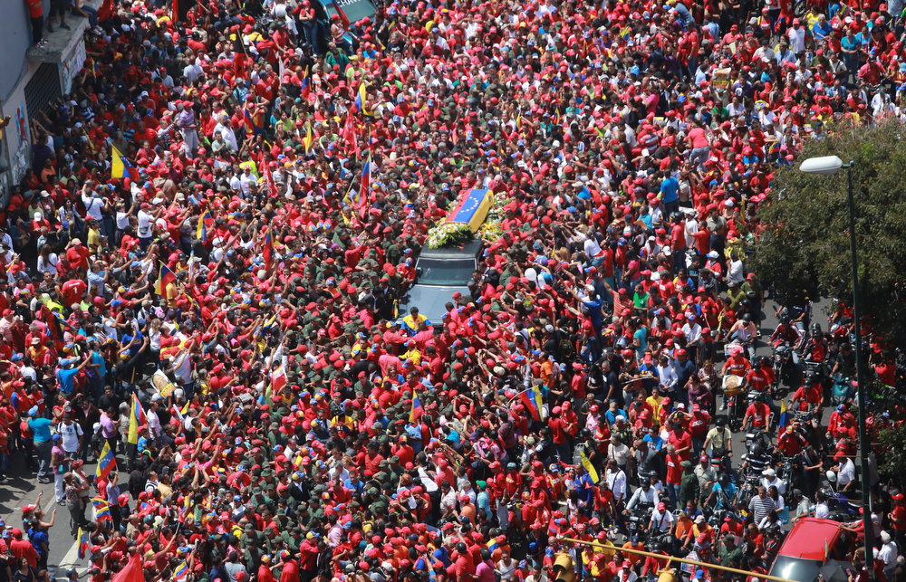 . The funeral cortege of late Venezuelan President Hugo Chavez on its way to the Military Academy on March 6, 2013 in Caracas. The flag-draped coffin of Venezuelan leader Hugo Chavez was borne through throngs of weeping supporters on Wednesday as a nation bade farewell to the firebrand leftist who led them for 14 years.  PRENSA MIRA FLORES FRANCISCO BATISTA/AFP/Getty Images