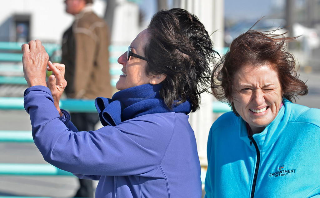 . Cheryl Abel, left and friend Jane Phillips came out to look at the wind and waves at the Manhattan Beach Pier Monday. Photo by Brad Graverson 4-8-13
