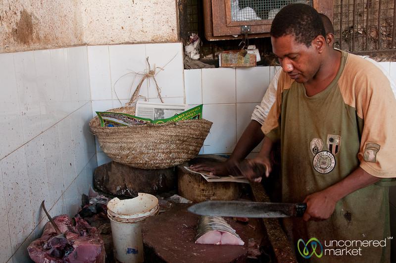 Fish Vendor Slicing White Fish - Stone Town, Zanzibar