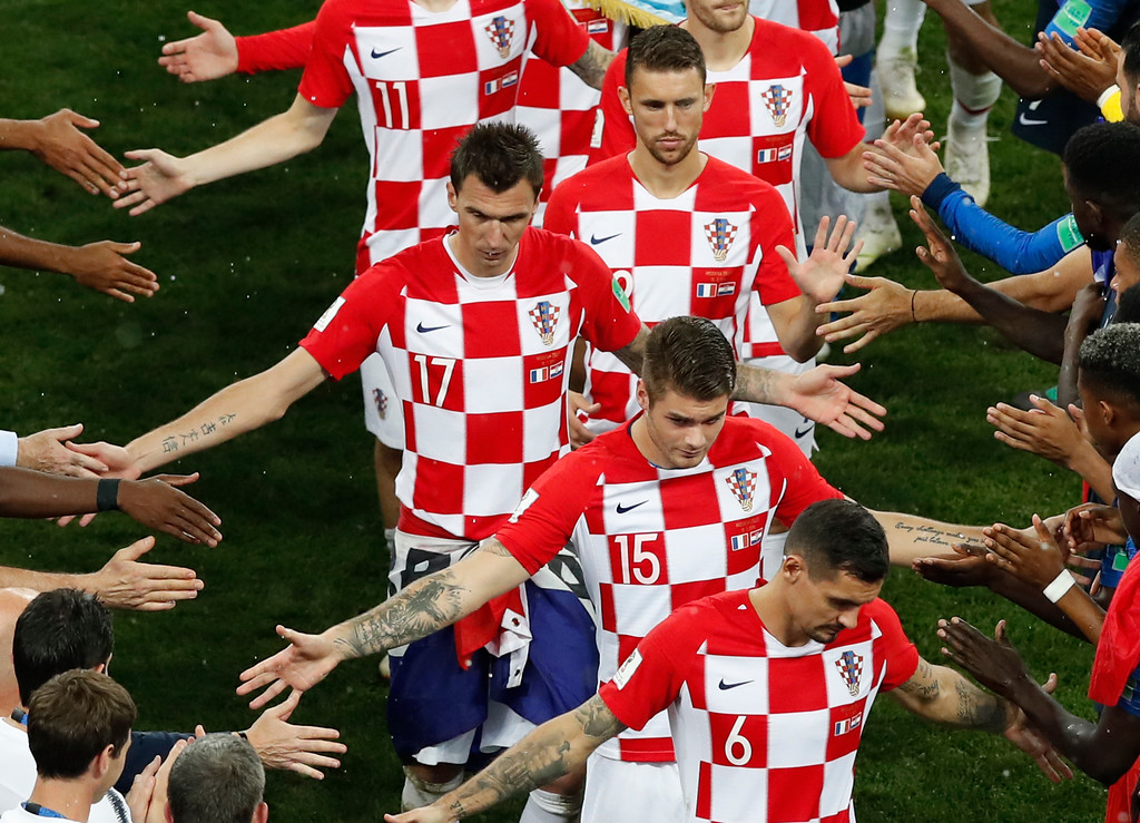 . Croatia players are recognized by French players and staff after their defeat by France in the final match at the 2018 soccer World Cup in the Luzhniki Stadium in Moscow, Russia, Sunday, July 15, 2018. (AP Photo/Rebecca Blackwell)