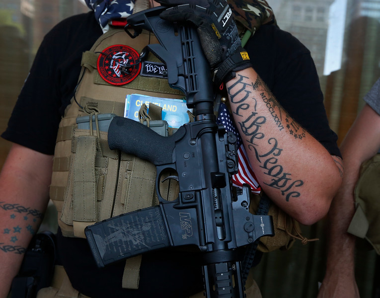 A member of the West Ohio Minutemen stands along a sidewalk in downtown Cleveland during the Republican National Convention in Ohio on July 20, 2016.