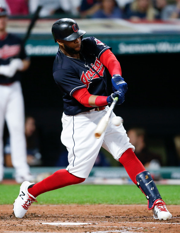 . Cleveland Indians\' Carlos Santana singles off Minnesota Twins starting pitcher Adalberto Mejia during the fourth inning in a baseball game, Wednesday, Sept. 27, 2017, in Cleveland. (AP Photo/Ron Schwane)