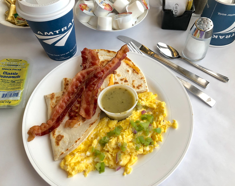 Breakfast of bacon, eggs, quesadilla, guacamole, and coffee served in Amtrak Dining Car