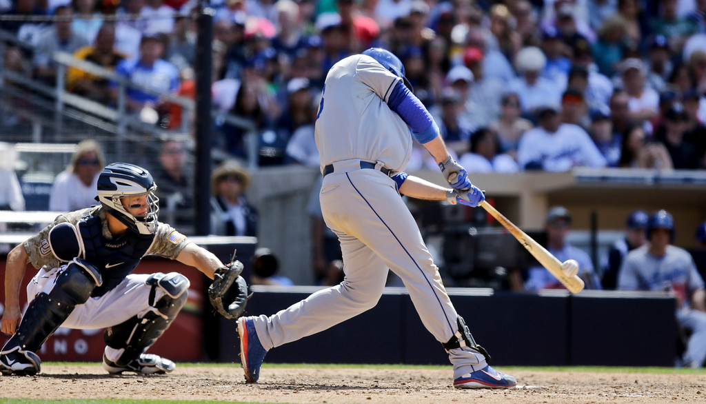 . Los Angeles Dodgers\' Adrian Gonzalez connects for a solo home run against the San Diego Padres in the ninth inning of a baseball game in San Diego, Sunday, June 23, 2013.  he home run gave the Dodgers the lead and the 3-1 victory. (AP Photo/Lenny Ignelzi)