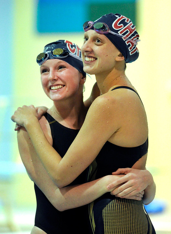 . Annie Graves, left, and Megan Grier, right, embraced after racing in the 400_Yard Freestyle Relay for Chaparral High School. The Colorado Coaches Invitational Swimming and Diving Meet wrapped up Saturday night, December 15, 2012.  Karl Gehring/The Denver Post