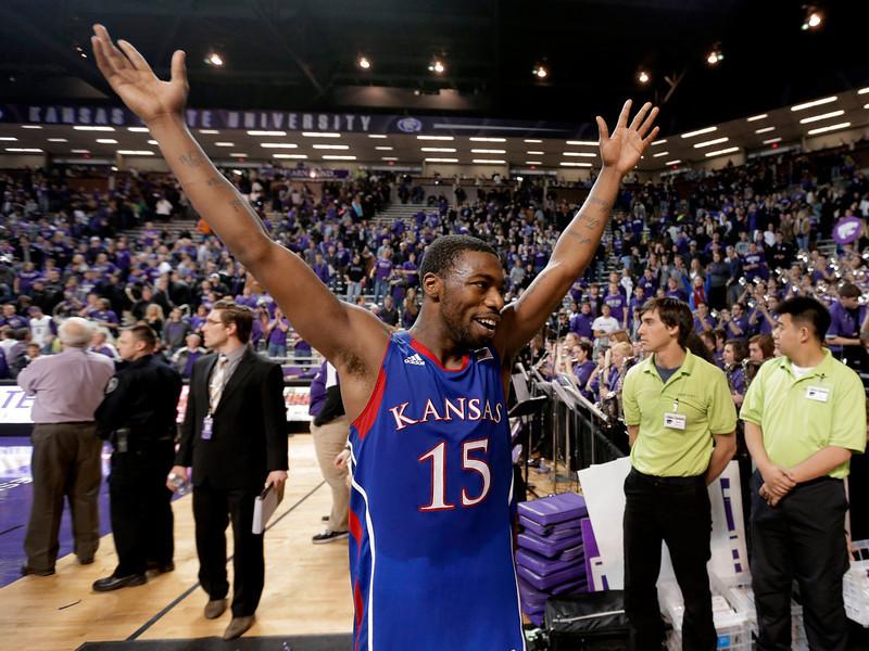 . Kansas guard Elijah Johnson celebrates after an NCAA college basketball game against Kansas State on Tuesday, Jan. 22, 2013, in Manhattan, Kan. Kansas won 59-55. (AP Photo/Charlie Riedel)