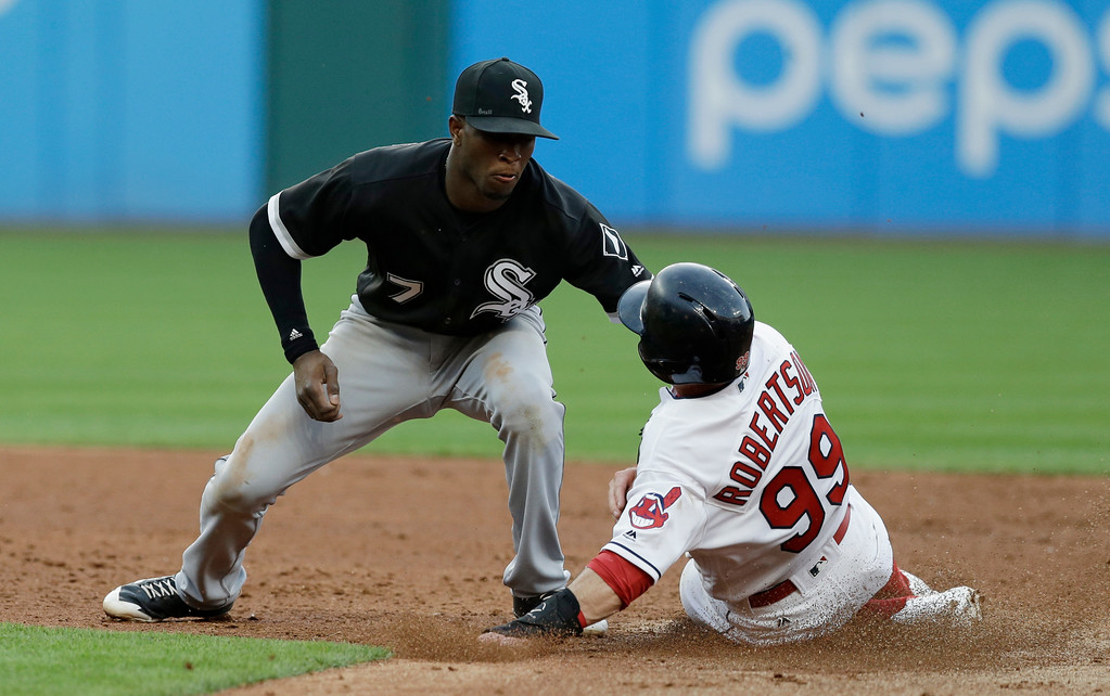 . Cleveland Indians\' Daniel Robertson advances to second base as Chicago White Sox\'s Tim Anderson is late on the tag in the third inning of a baseball game, Saturday, June 10, 2017, in Cleveland. (AP Photo/Tony Dejak)
