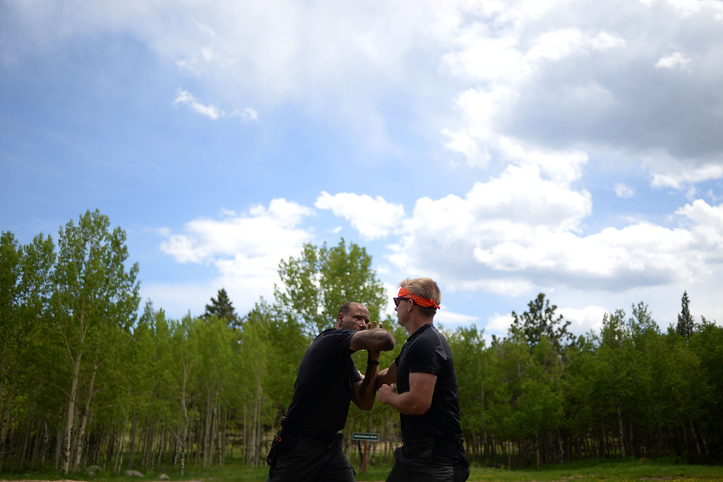 . WARD, CO - JUNE 10: Instructor Matthew Bragg (left) instructs students on self defense using Don Fletcher as an example. Bear Grylls survival school at Glacier View Ranch near Ward, Colorado on Tuesday, June 10, 2014. (Photo by AAron Ontiveroz/The Denver Post)