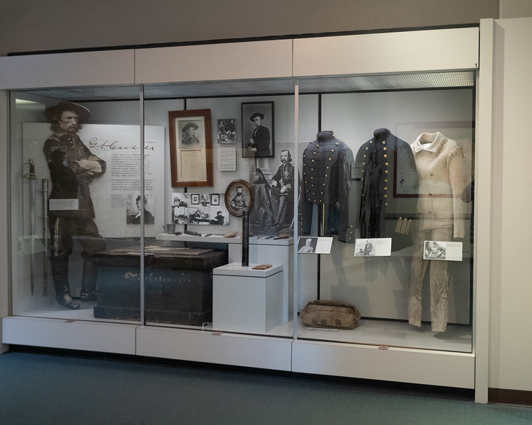 Military uniforms in a display case