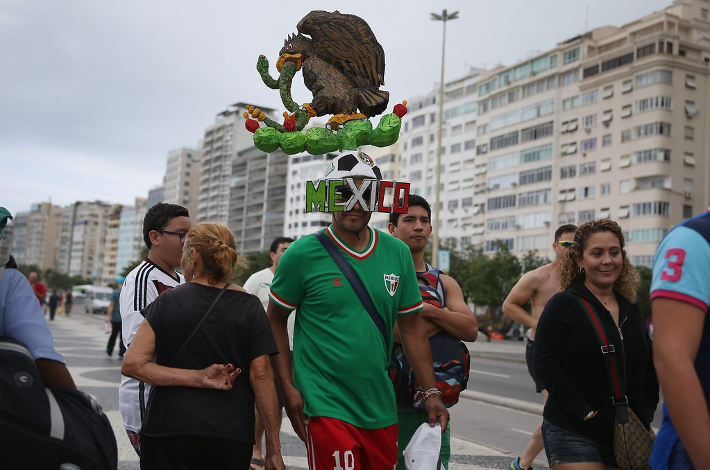 . Mexican soccer fan, Cain Camacho from Chicago, Illinois shows his support for the Mexican soccer team on Copacabana beach as he awaits the start of the World Cup tournament on June 10, 2014 in Rio de Janeiro, Brazil.   Brazil continues to prepare to host the World Cup which starts on June 12th and runs through July 13th.  (Photo by Joe Raedle/Getty Images)