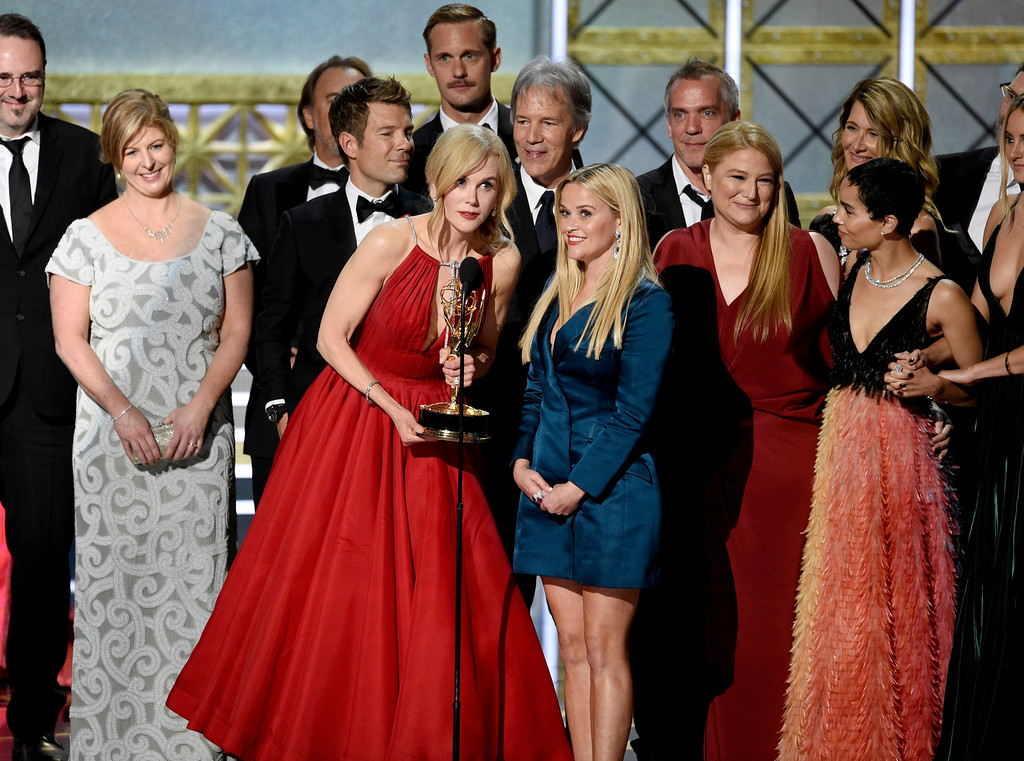 """. Nicole Kidman, center left, Reese Witherspoon, center right, and cast and crew accept the award for outstanding limited series for \""""Big Little Lies\"""" at the 69th Primetime Emmy Awards on Sunday, Sept. 17, 2017, at the Microsoft Theater in Los Angeles. (Photo by Chris Pizzello/Invision/AP)"""