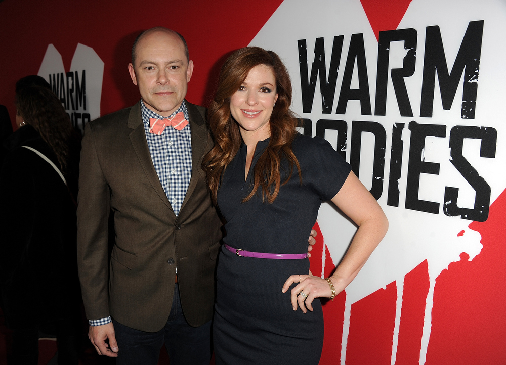 "Description of . Actor Rob Corddry and wife Sandra arrive for the Los Angeles premiere of Summit Entertainment\'s ""Warm Bodies\"" at ArcLight Cinemas Cinerama Dome on January 29, 2013 in Hollywood, California.  (Photo by Kevin Winter/Getty Images)"