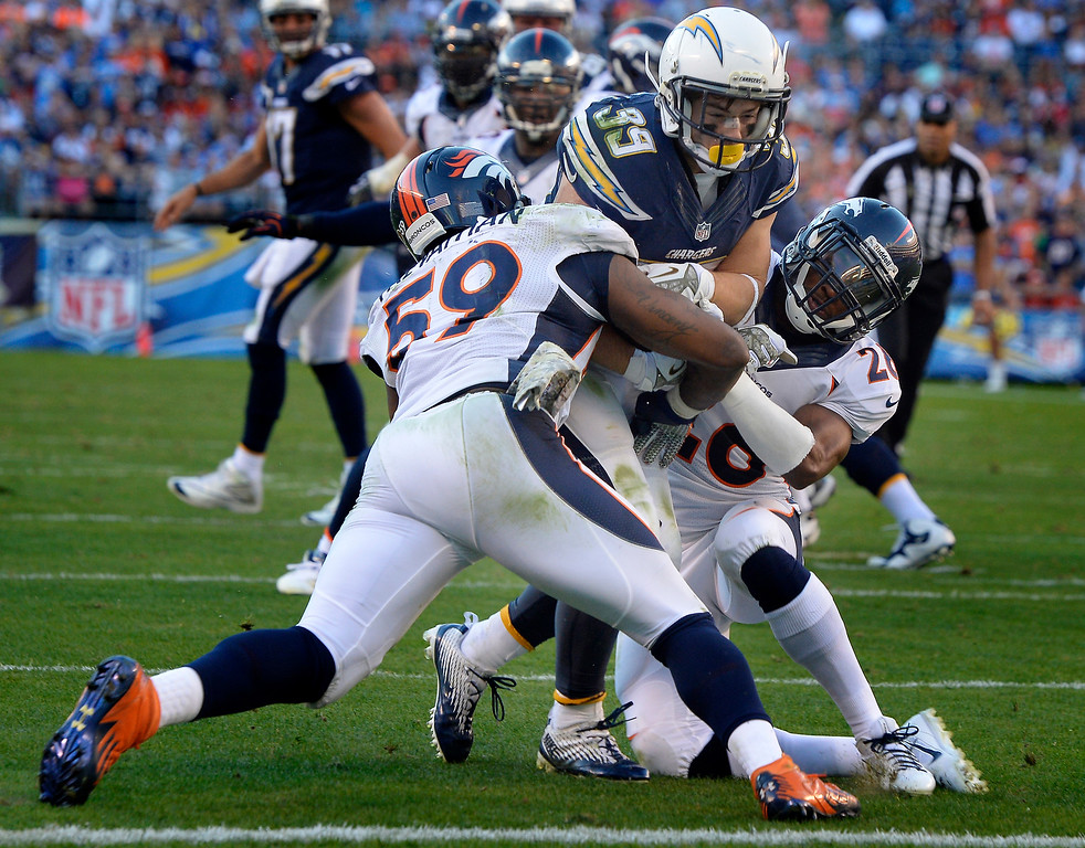 . Running back Danny Woodhead #39 of the San Diego Chargers is sandwiched at the goal line by outside linebacker Danny Trevathan #59 and free safety Rahim Moore #26 of the Denver Broncos at Qualcomm Stadium November 10, 2013 San Diego, CA. (Photo By Joe Amon/The Denver Post)