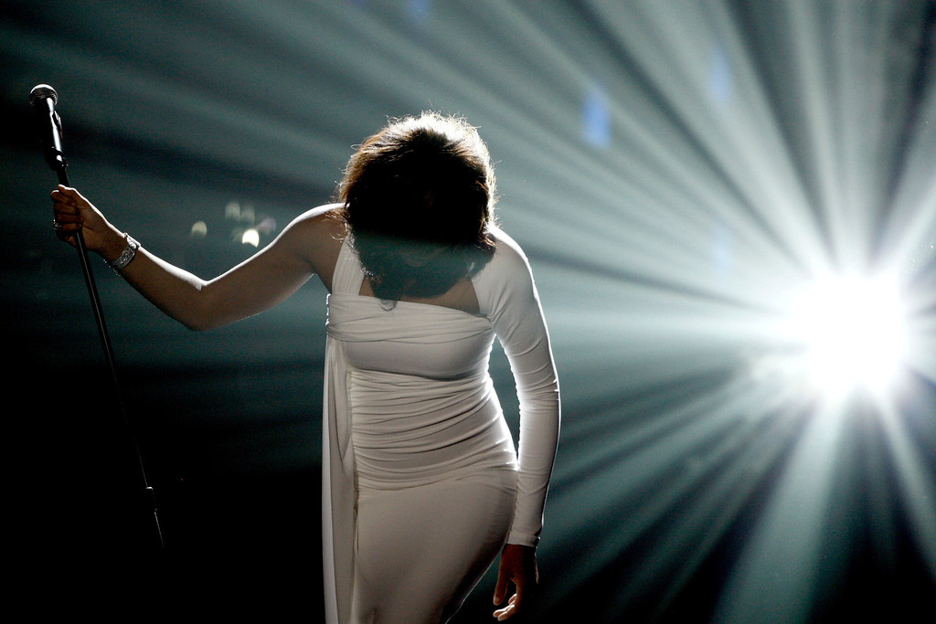 . Artist Whitney Houston performs onstage at the 37th Annual  American Music Awards on Sunday, Nov. 22, 2009, in Los Angeles. Houston was born August 9, 1963 in Newark, New Jersey and died February 11, 2012, in Beverly Hills, California at the age of 48. (AP Photo/Matt Sayles)