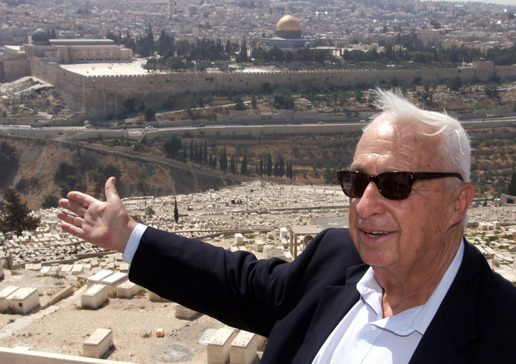 . Opposition leader Ariel Sharon of the right-wing Likud gestures towards Jerusalem\'s Old City 24 July 2000 on the Mount of Olives during a rally to protest any land concessions in Jerusalem to the Palestinians.  AFP PHOTO/ MENAHEM KAHANA/AFP/Getty Images