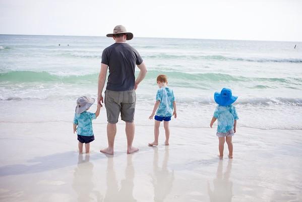 all four boys on the beach