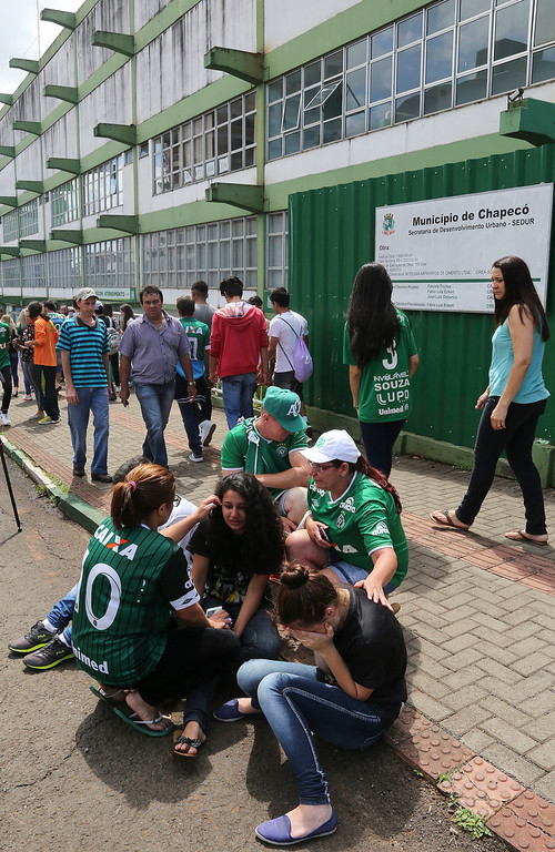 . Fans of Brazil\'s soccer team Chapecoense gather at the Arena Conda stadium in Chapeco, Brazil, Tuesday, Nov. 29, 2016. A chartered plane that was carrying the Brazilian soccer team to the biggest match of its history crashed into a Colombian hillside and broke into pieces, killing 75 people and leaving six survivors, Colombian officials said Tuesday. (AP Photo/Andre Penner)