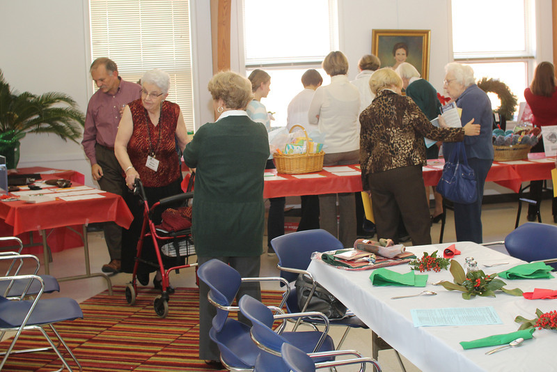 Action at the silent auction tables - Norma was determined to get one of the vacation homes.