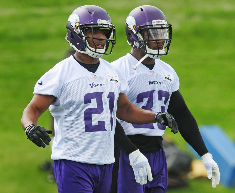 . Vikings cornerback Josh Robinson, left, and safety Jamarca Sanford watch the action during the team\'s minicamp on Tuesday.  (Pioneer Press: Scott Takushi)